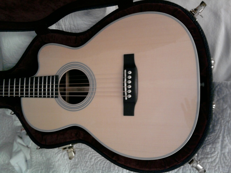 how to raise a low fret