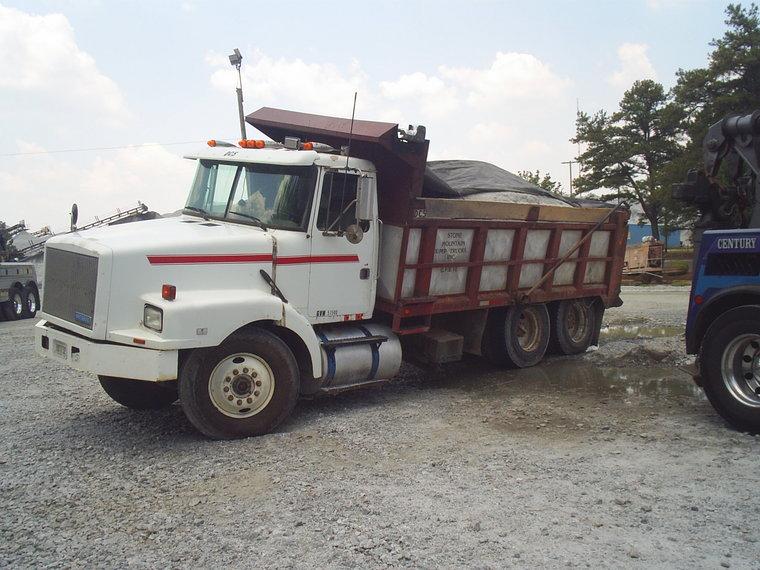 Broken suspension on a loaded dump truck - Tow411