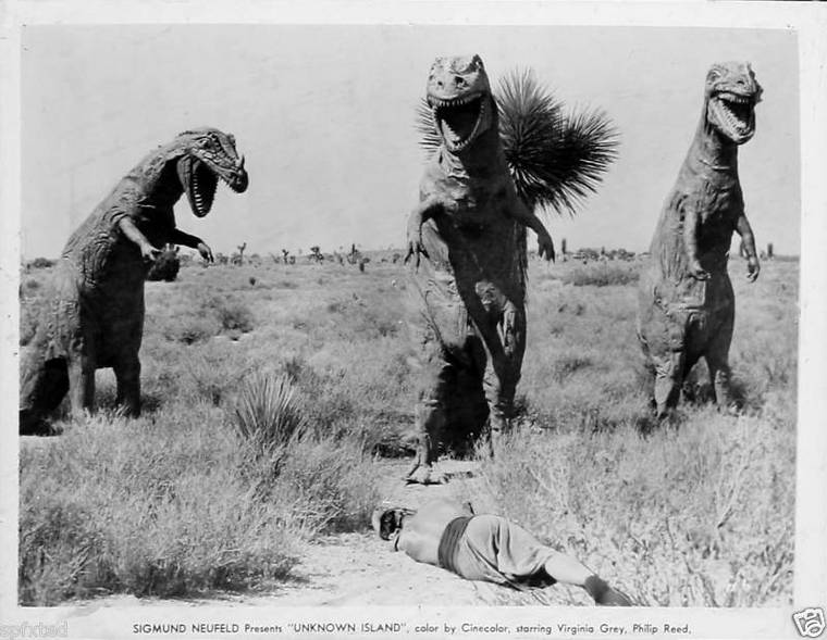 T-rexes standing over a kill from Unknown Island 1948.