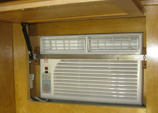 Window ac installed in top of closet in vintage trailer for 110 window unit